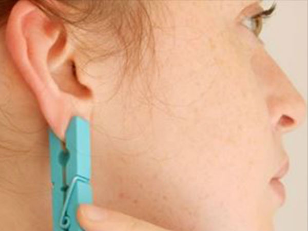 She puts a clothespin on her ear for one brilliant reason.