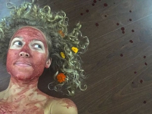 Woman Smears Blood On Her Face As She Feels Beautiful Powerful
