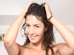 Woman Washes Hair With To Get Rid Of Dandruff