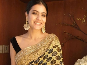 Kajol Ddevgan Classy Black And Golden Sari Look